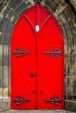 明亮的红色门 库存照片