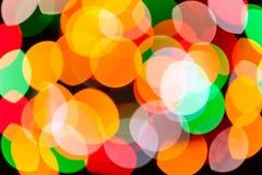 明亮的被弄脏的欢乐和五颜六色的圣诞灯提取背景纹理 库存图片