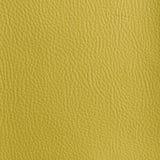 明亮的黄色皮革织地不很细背景 免版税图库摄影