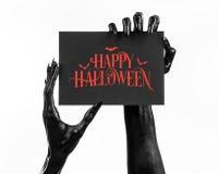 明信片和愉快的万圣夜题材:拿着与词在白色的愉快的万圣夜的死亡的黑手党一个纸牌隔绝了ba 库存照片