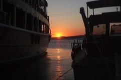黄昏风景通过两条小船 库存照片