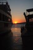黄昏风景通过两条小船 免版税库存照片
