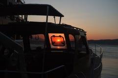 黄昏风景通过小船 库存照片