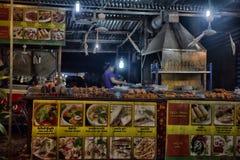 贸易商在夜市场上在泰国 库存图片