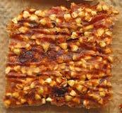 易碎片断未加工的食物的荞麦,特写镜头(宏指令) 免版税库存照片