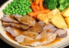 星期天烤小羊晚餐 库存照片