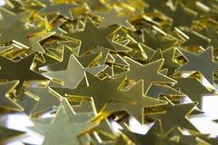 星状金黄衣服饰物之小金属片宏指令  免版税库存照片