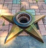 以星的形式纪念火焰 免版税库存照片