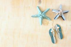 星鱼和木触发器装饰 免版税库存照片