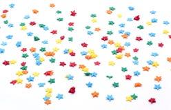 星洒在白色背景的糖 免版税库存图片