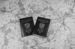 映射和准备好两本的护照使用 北京,中国黑白照片 免版税库存照片
