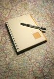 映射笔记本 免版税库存图片