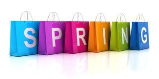 春天与购物袋的销售概念 免版税库存照片