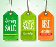 春天为季节性商店促进垂悬设置的销售标记 免版税库存照片