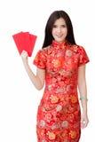 春节概念,佩带红色礼服藏品的亚裔妇女 免版税库存照片