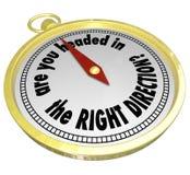 是您朝向在正确的方向指南针正确道路 免版税库存照片