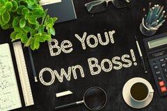 是您自己的上司-在黑黑板的文本 3d翻译 免版税库存照片
