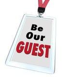 是我们的客人徽章短绳欢迎访客 免版税图库摄影