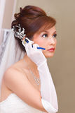 是新娘移动电话联系 库存图片