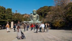 是最著名的日本阿弥陀佛的巨大的室外古铜色雕象  库存图片