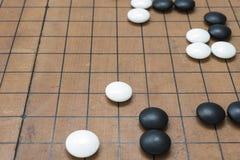 染黑石头的白色石方法去比赛板.