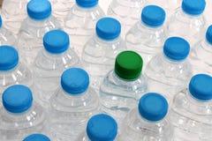 是瓶装塑料被回收的水于罐中 免版税库存照片