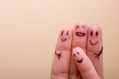 是非常愉快是朋友的三个微笑的手指 免版税库存照片