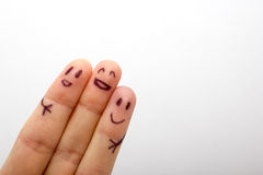 是非常愉快是的三个微笑的手指 免版税库存照片