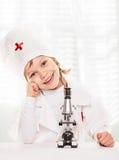 显微镜男孩 库存照片