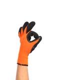 显示一个好标志的庭院橙色手套 免版税库存照片