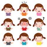 显示不同的情感的逗人喜爱的女孩面孔 库存照片