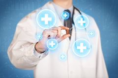 显示与十字架的医生一个药片 免版税库存图片
