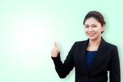 显示与微笑的女商人赞许在隔绝 免版税库存照片