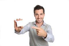 显示与手指的人一个空插件 免版税图库摄影