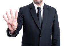 显示与手指的商人第四 库存照片