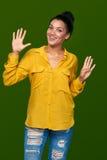 显示九个手指的妇女 图库摄影