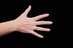 显示五个手指的妇女手 免版税库存照片