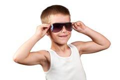 显示他的肌肉的男孩查出在白色 图库摄影