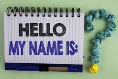 显示你好我的名字的文字笔记是 企业照片陈列的会议某人书面的新的介绍采访介绍 免版税库存图片