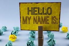 显示你好我的名字的文字笔记是 企业照片陈列的会议某人书面的新的介绍采访介绍 库存照片