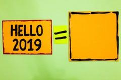 显示你好的文字笔记2019年 企业照片陈列的盼望伟大为以后的新年橙色纸n发生 图库摄影