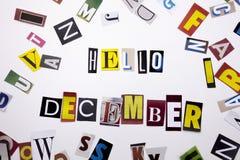 显示你好12月的概念词文字文本由企业案件的另外杂志报纸信件制成在白色b 库存图片