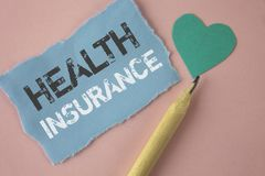显示健康保险的概念性手文字 企业照片陈列的健康保险信息覆盖面医疗保健provi 免版税库存照片