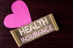 显示健康保险的概念性手文字 企业照片陈列的健康保险信息覆盖面医疗保健provi 免版税库存图片