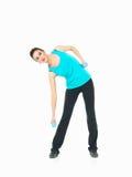 显示健身的性感的妇女移动,空白背景 免版税库存照片