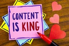显示内容的概念性手文字是国王 企业照片文本文章或岗位可能保证您成功广告writt 免版税库存图片