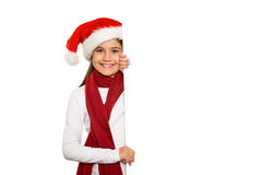显示卡片的欢乐的小女孩 库存图片