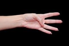显示四个手指的妇女现有量 免版税库存照片