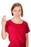 显示四个手指的愉快的微笑的妇女画象  库存照片