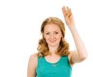 显示四个手指的愉快的微笑的妇女画象  免版税库存图片